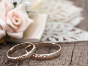 wedding-rings-on-wood